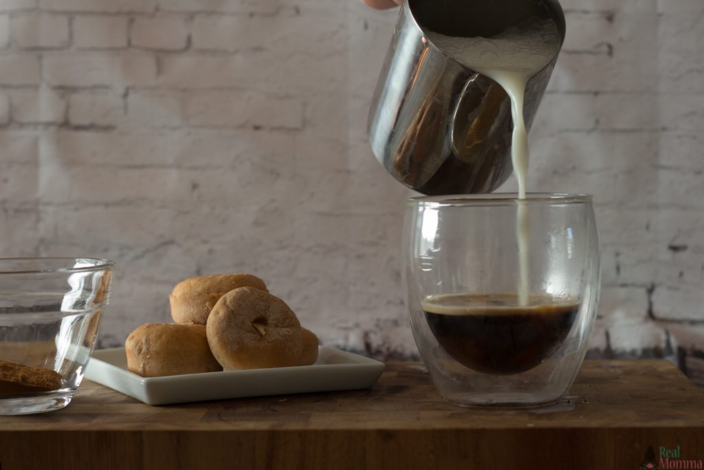 add steamed milk to the espresso and syrup